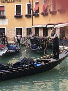 Jousting gondoliers. Real Venetians never ride in gondolas.