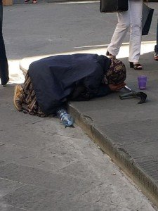 Prostrate Vendor begs for mercy after being asked for directions.